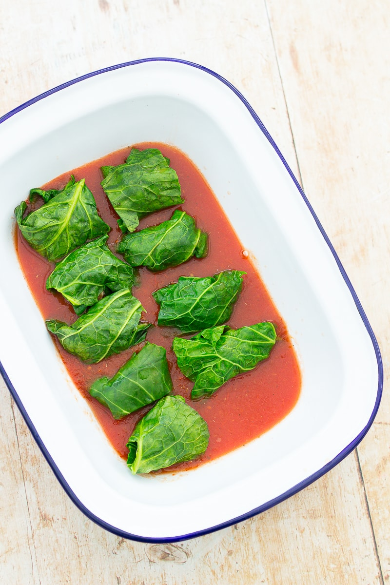 Easy Sausage Parcels - tomato sauce and wrapped sausages in an oven dish
