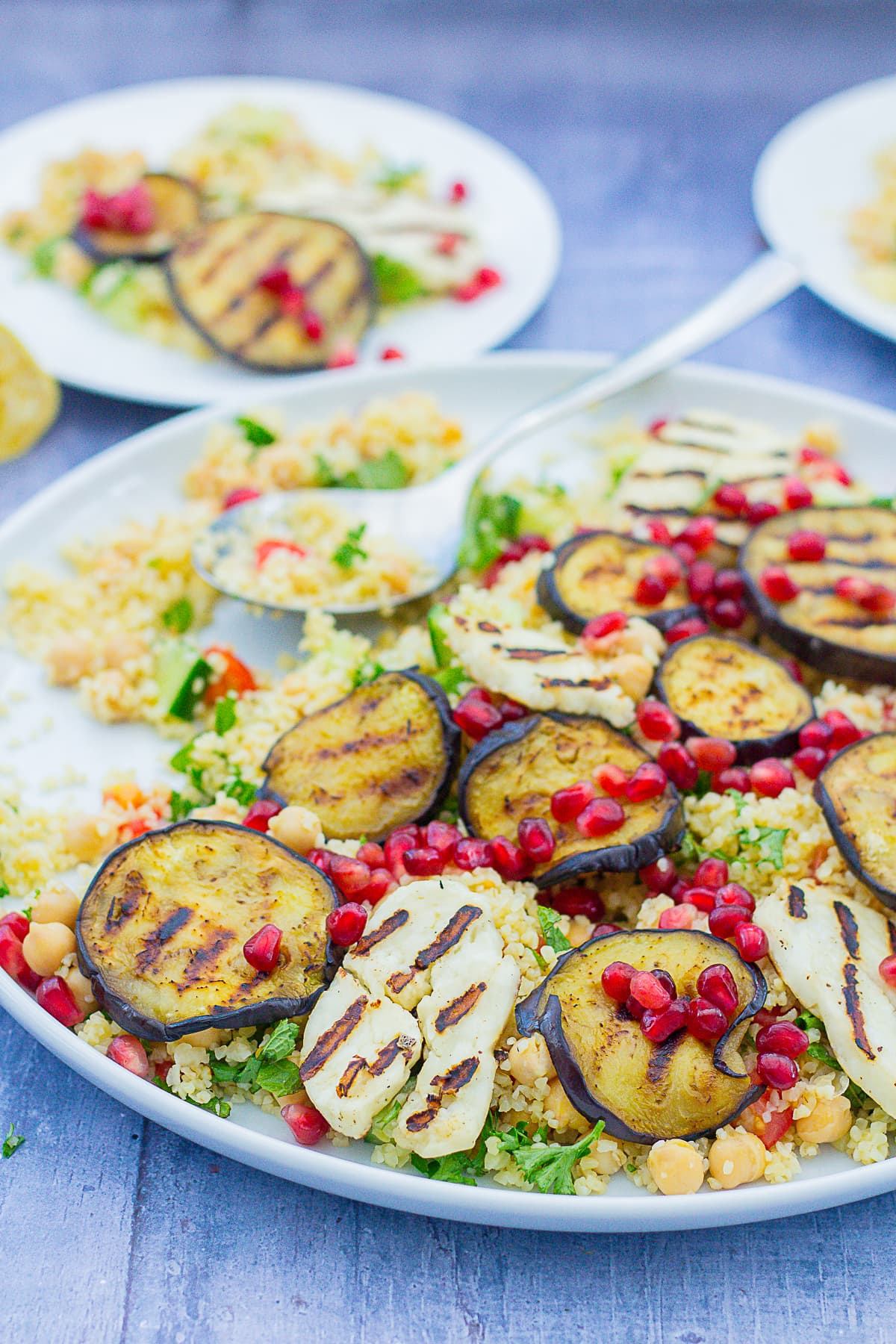 Aubergine and Halloumi Salad on a serving platter and two smaller plates