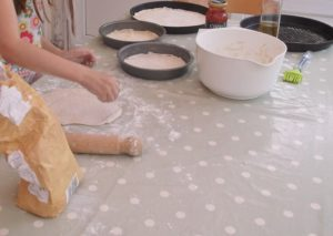 Rolling out pizza bases