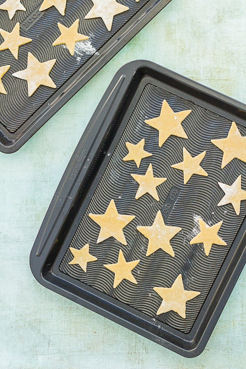 Uncooked Easy Peasy Christmas Star Biscuits on a baking tray