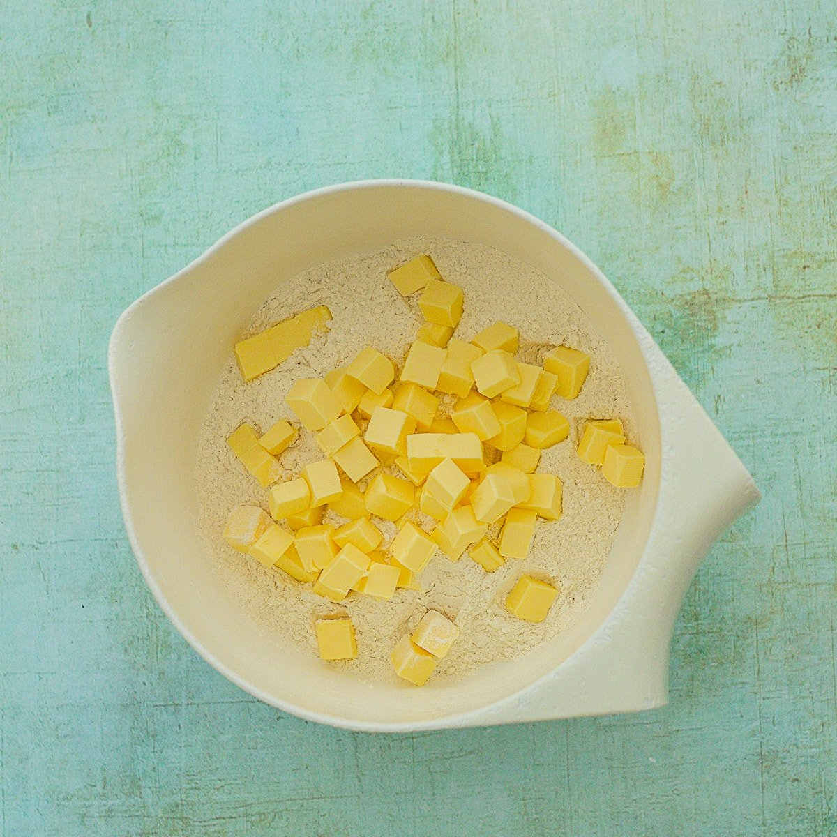 Flour and cubed butter in a bowl