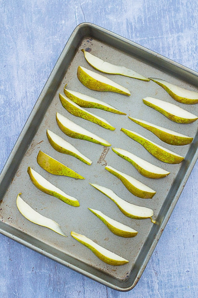 Pear eighths on a roasting tray ready to go into the oven