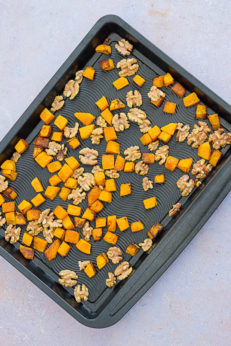 Roasted Butternut Squash and Walnuts on an oven tray