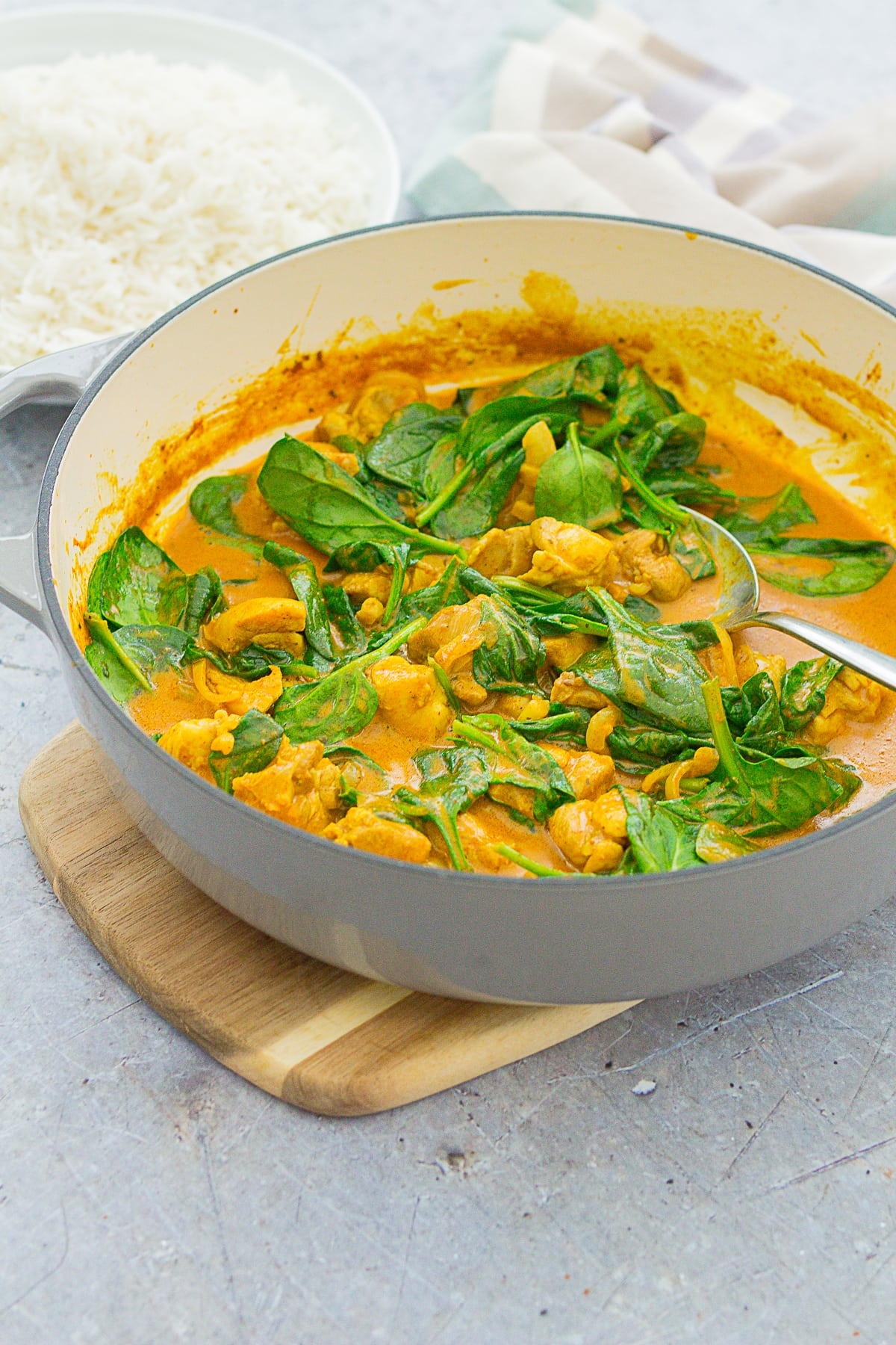 Quick Chicken and Spinach Curry (Chicken Saag) in a pan next to some basmati rice