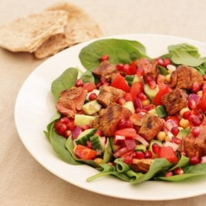 Harissa Lamb with Chickpea, Spinach and Pomegranate Salad