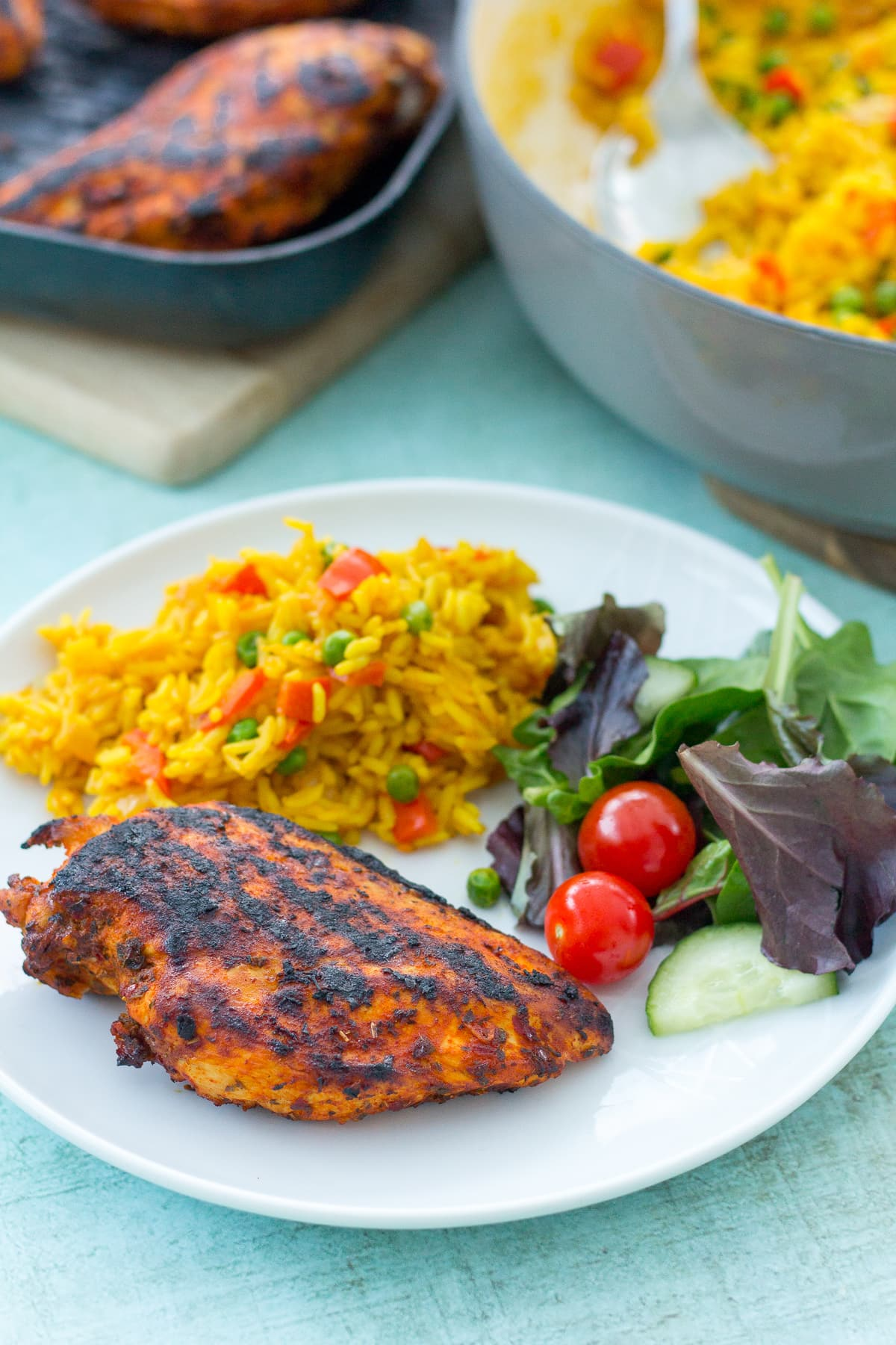 Homemade Nandos Spicy Rice and Easy Peri Peri Chicken Breasts served together.