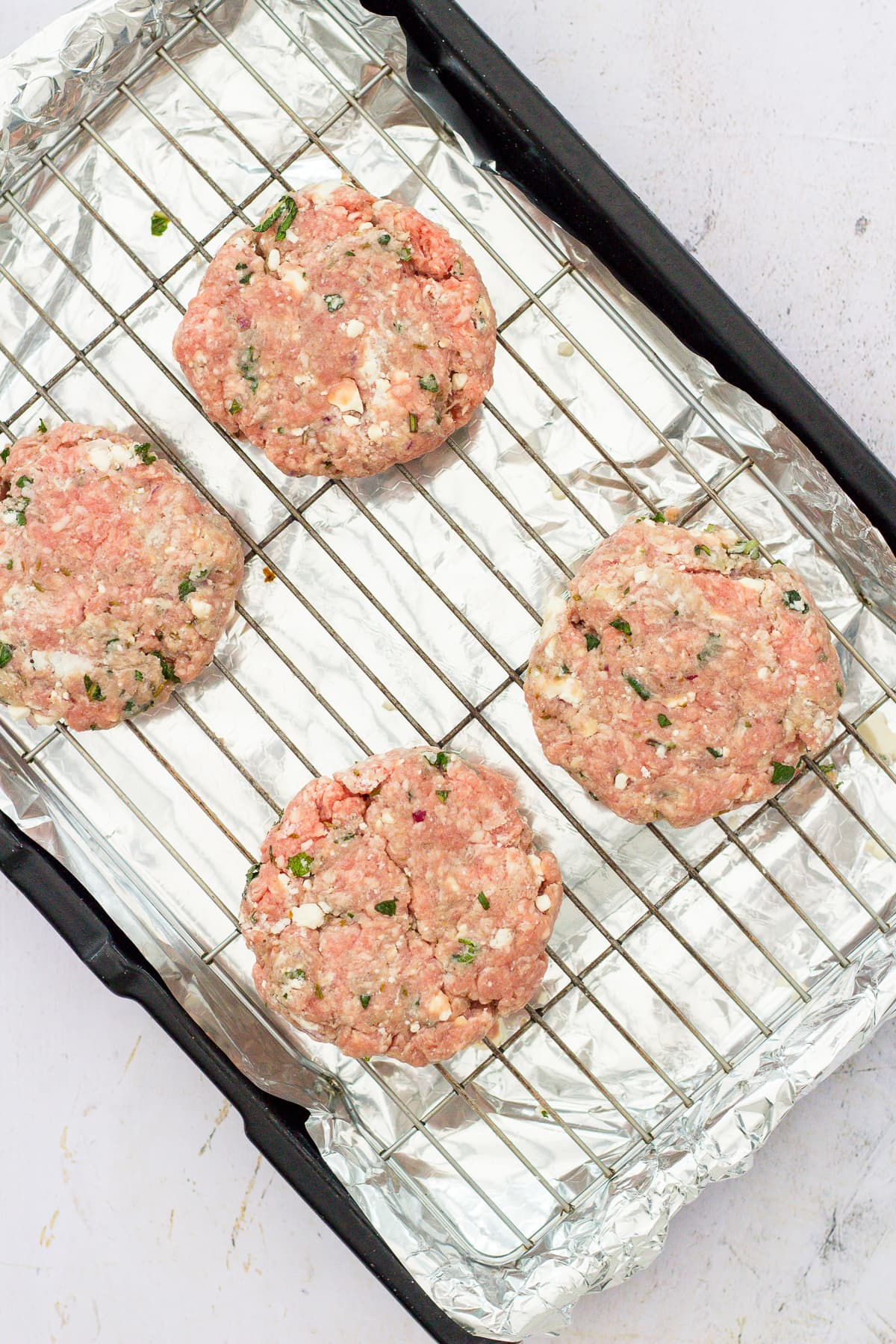 Lamb Feta and Mint Burgers ready to go into the oven