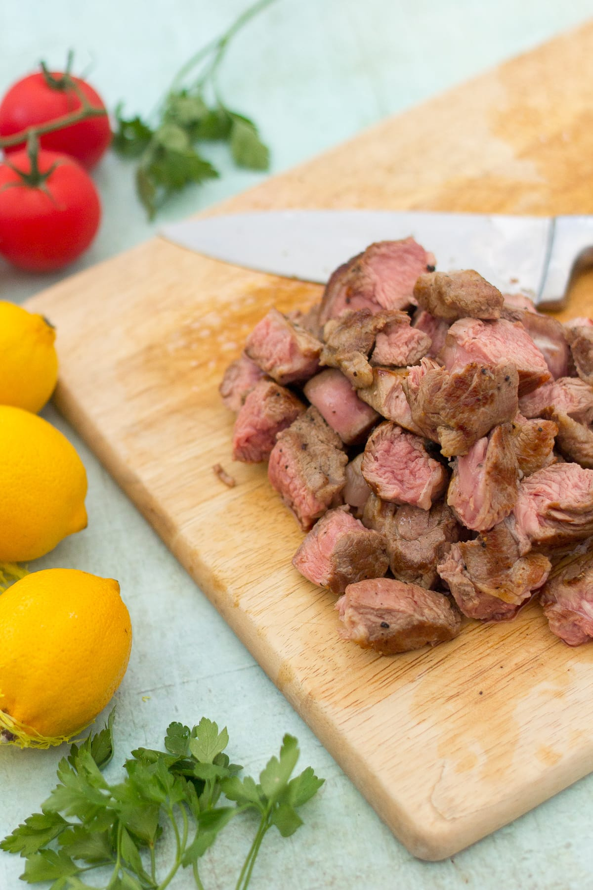 Pan fried lamb leg steaks (diced)