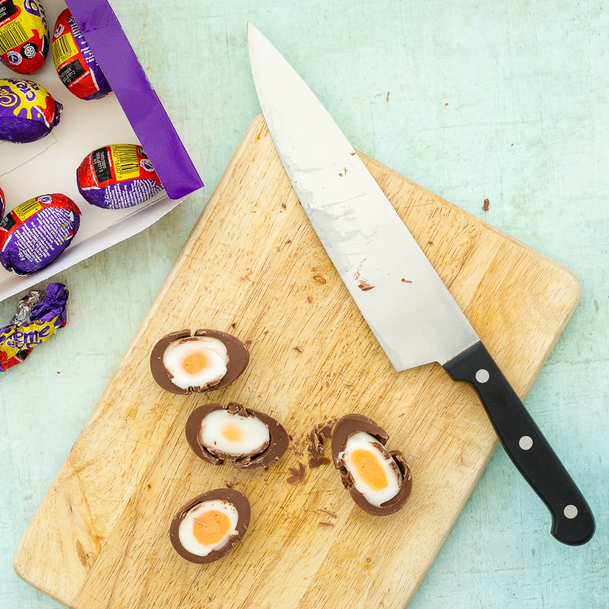 Cut creme eggs in half - for Easy Creme Egg Brownies