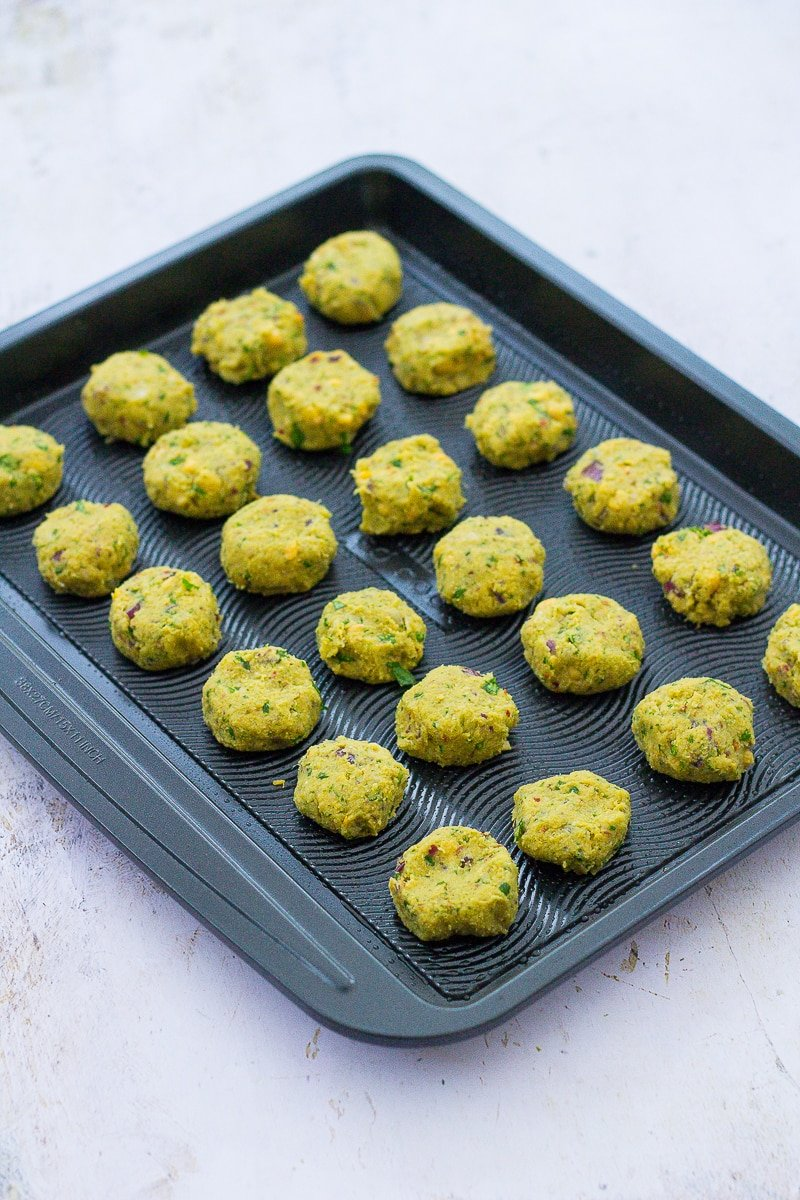 Uncooked Easy Oven Baked Falafel on a baking sheet