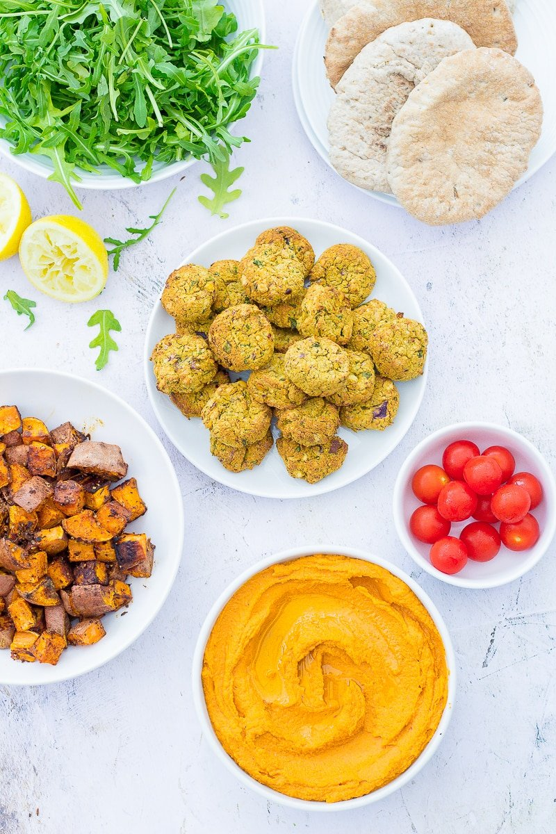 Easy Oven Baked Falafel as part of a mezze spread