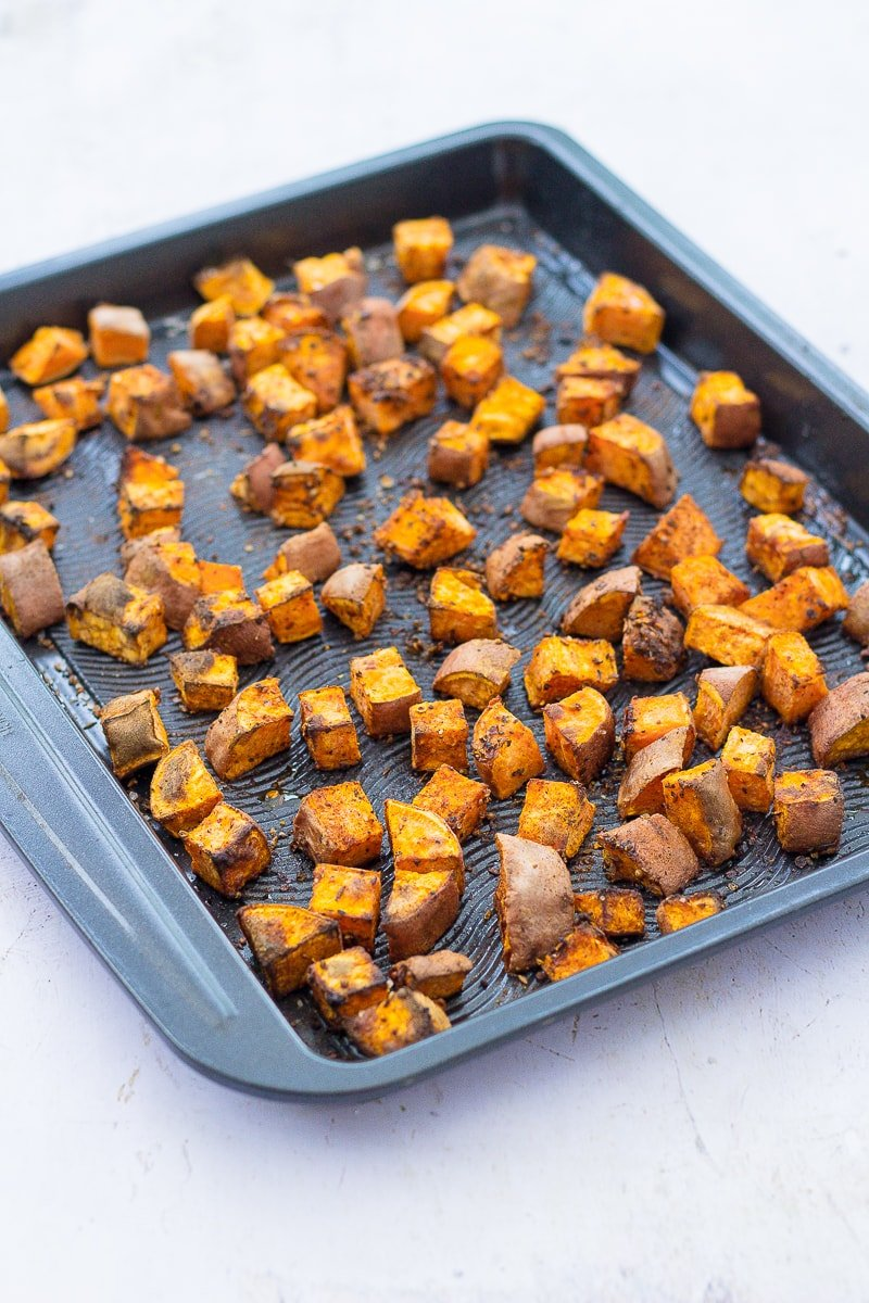 Cooked Baharat Roasted Sweet Potato Cubes on a tray