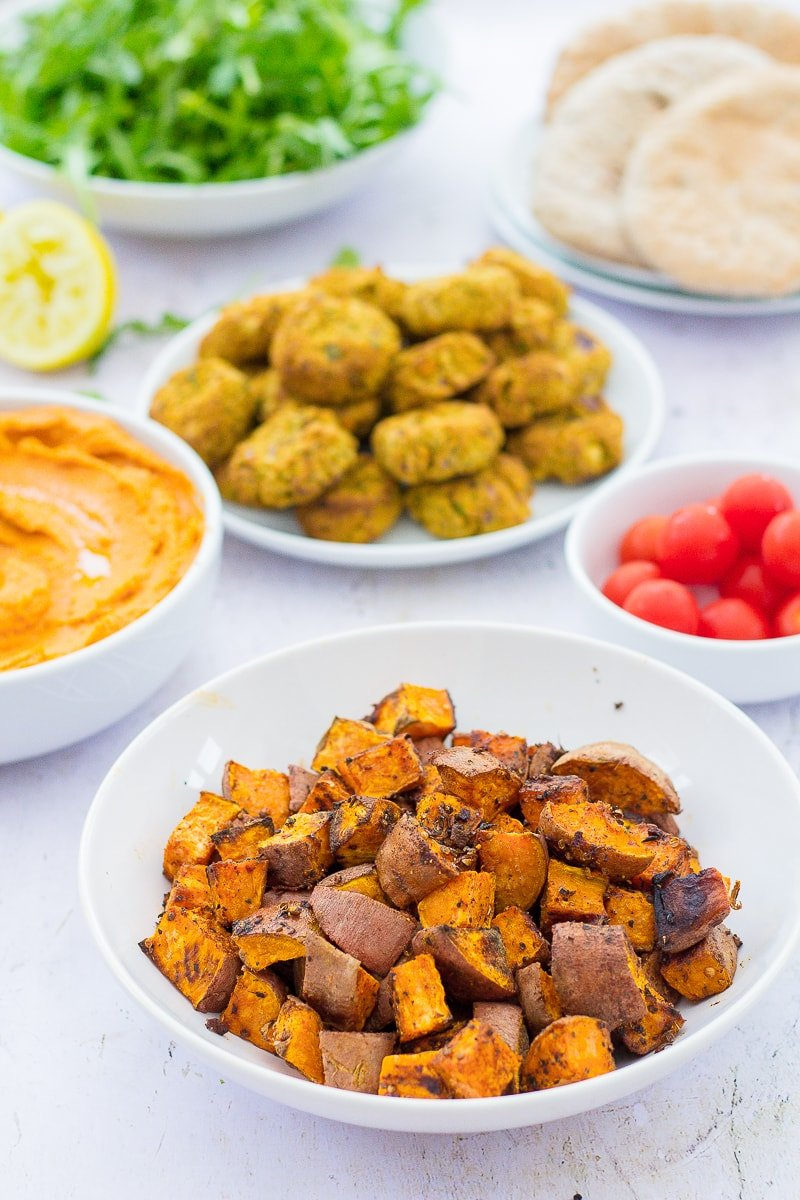 Baharat Roasted Sweet Potato Cubes as part of a mezze spread with hummus, falafels, pittas and salad