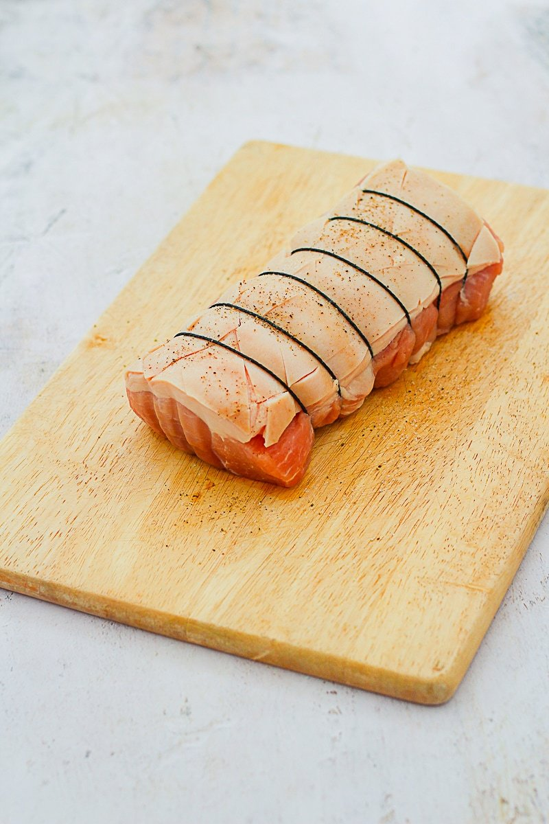Raw pork crackling joint, rind cut in a diamond pattern, salt and pepper on top