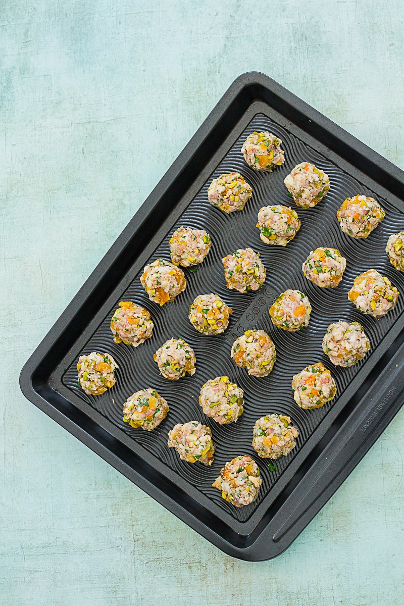Easy Apricot and Pistachio Stuffing Balls on a baking tray ready to go into the oven