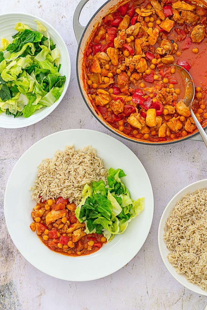 Overhead of Easy Chicken, Chorizo and Chickpea Stew with green cabbage and brown rice