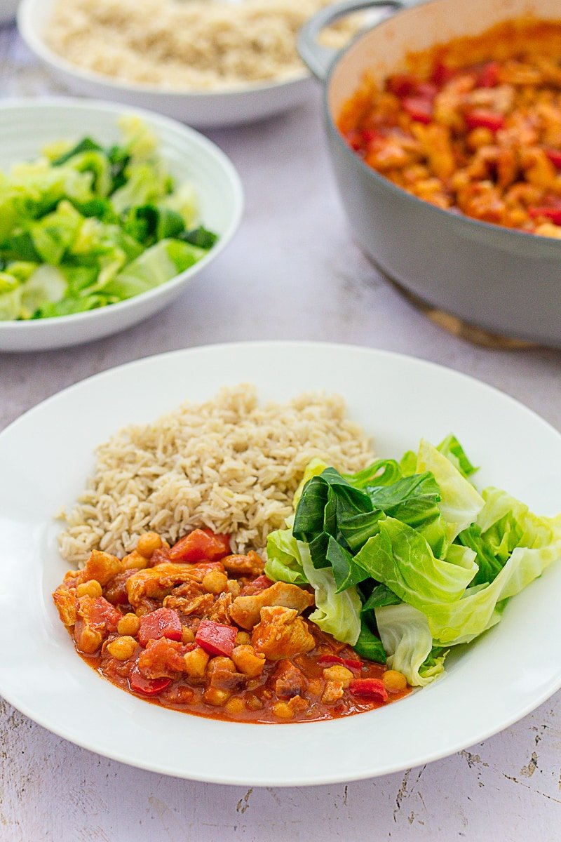 Easy Chicken, Chorizo and Chickpea Stew with green cabbage and brown rice