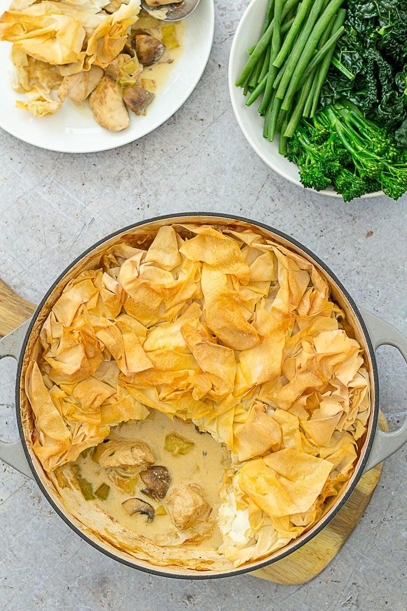 Overhead shot of Easy Peasy Chicken, Mushroom and Leek Pie and green vegetables