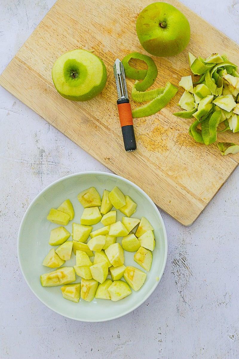 Bramley apples being prepared for Easy Peasy Apple Crumble