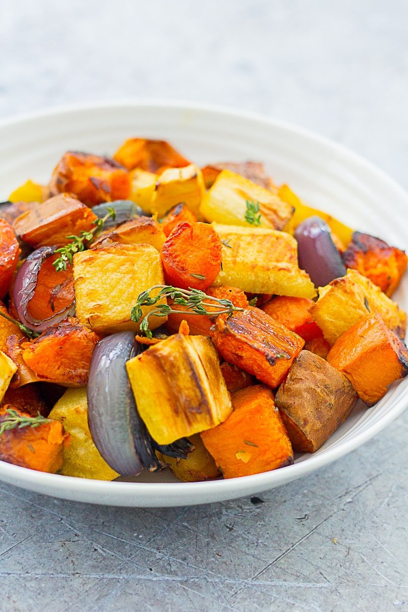 Eyelevel image of Easy Peasy Roasted Root Vegetables in a white bowl