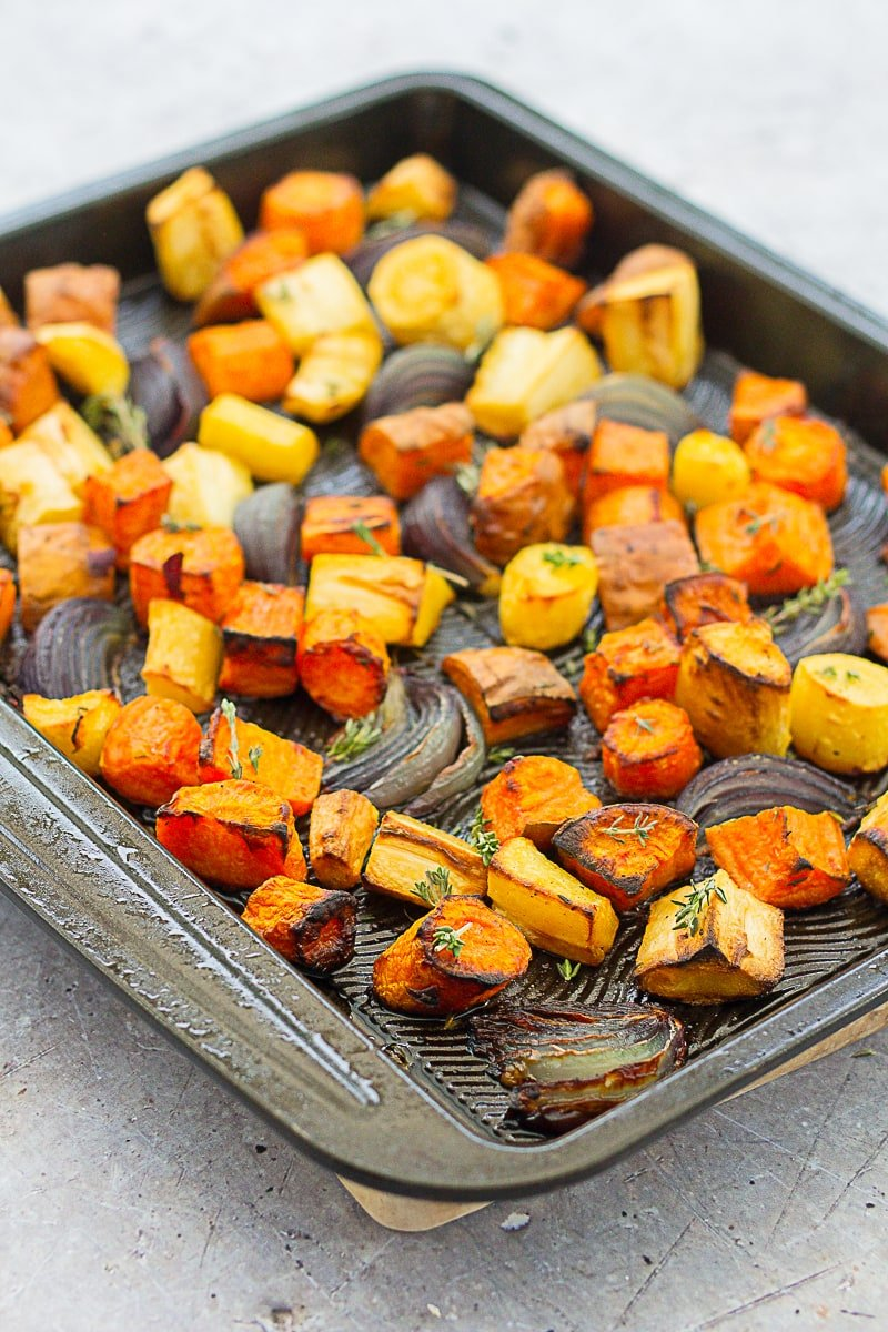 Easy Peasy Roasted Root Vegetables on a black roasting tray